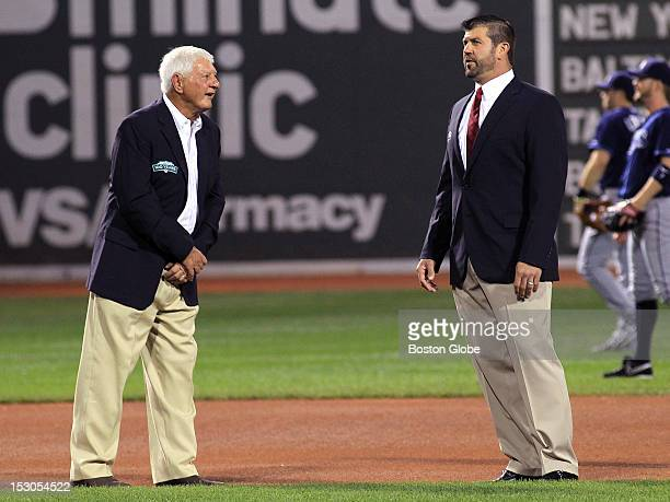 Carl Yastrzemsk talks with Jason Varitek as a member of the All Fenway Park team as they are honored in a pregame ceremony before the Red Sox take on...