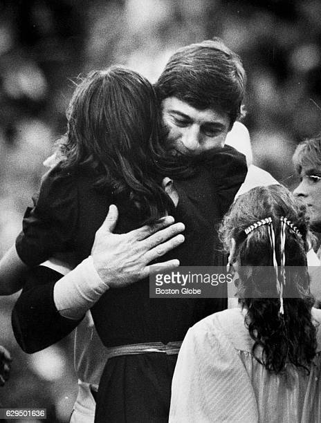 Carl Yastrzemski hugs family members during the celebration of his retirement at Fenway Park in Boston on Oct 1 1983 The day was called 'Yaz Day' to...