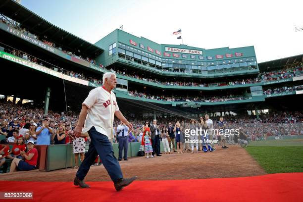 Carl Yastrzemski is recognized during a celebration to honor the American League Champion 1967 Red Sox team at Fenway Park on August 16 2017 in...