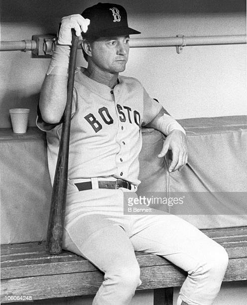 Carl Yastrzemski of the Boston Red Sox sits in the dugout before an MLB game against the New York Yankees on September 27 1983 at Yankee Stadium in...