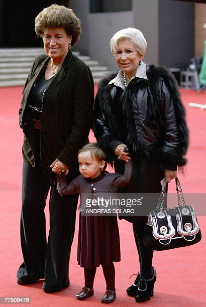 Carla and Anna Fendi the daughters of Edoardo Fendi who founded the Italian fashion house Fendi pose with their niece Annabelle before the screening...