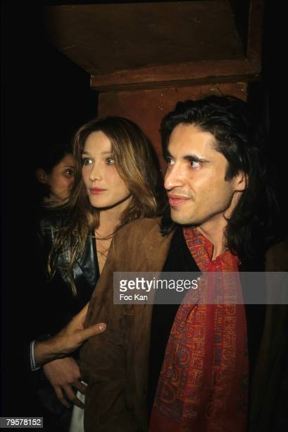 Carla Bruni and Arno Klarsfeld attend the Nadja Auermann Sushi Party at the Bains Club on October 11995 in Paris France