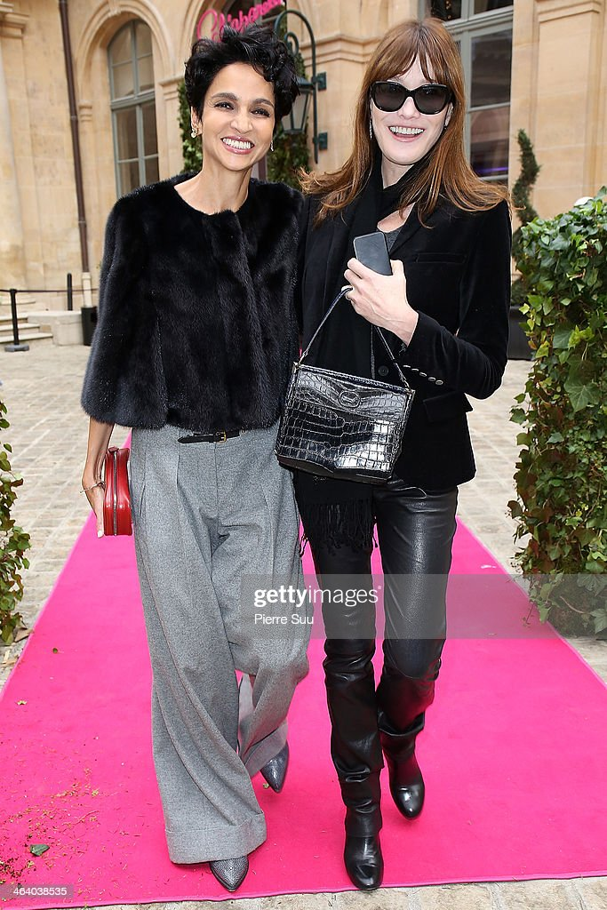 Carla Bruni and Farida Khelfa attend the Schiaparelli show as part of Paris Fashion Week Haute Couture Spring/Summer 2014> on January 20 2014 in...