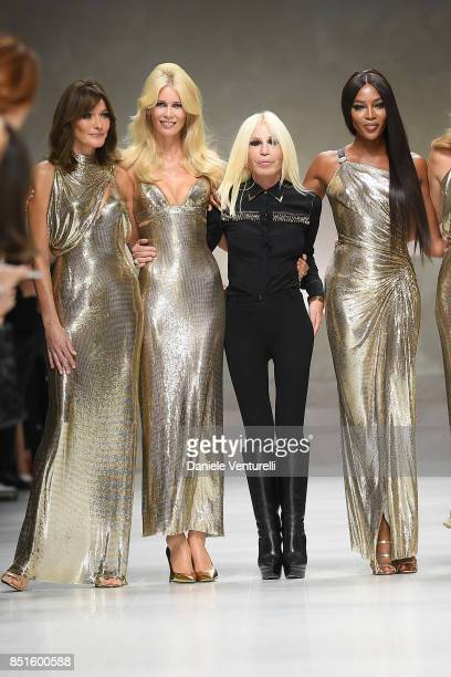 Carla Bruni Claudia Schiffer Donatella Versace and Naomi Campbell walk the runway at the Versace show during Milan Fashion Week Spring/Summer 2018 on...