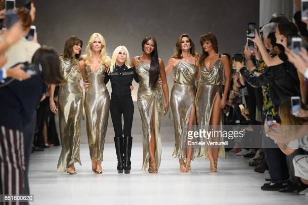 Carla Bruni Claudia Schiffer Donatella Versace Naomi Campbell Cindy Crawford and Helena Christensen walk the runway at the Versace show during Milan...