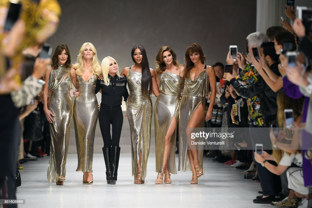 Carla Bruni, Claudia Schiffer, Donatella Versace, Naomi Campbell, Cindy Crawford and Helena Christensen walk the runway at the Versace show during Milan Fashion Week Spring/Summer 2018 on September 22, 2017 in Milan, Italy.
