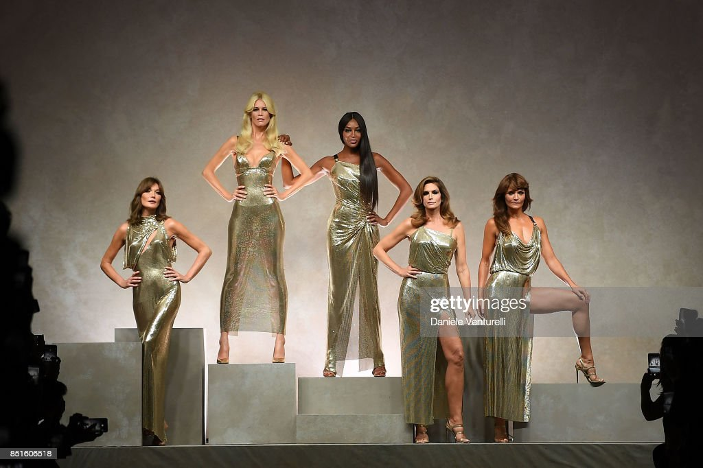 Carla Bruni, Claudia Schiffer, Naomi Campbell, Cindy Crawford and Helena Christensen walk the runway at the Versace show during Milan Fashion Week Spring/Summer 2018 on September 22, 2017 in Milan, Italy.