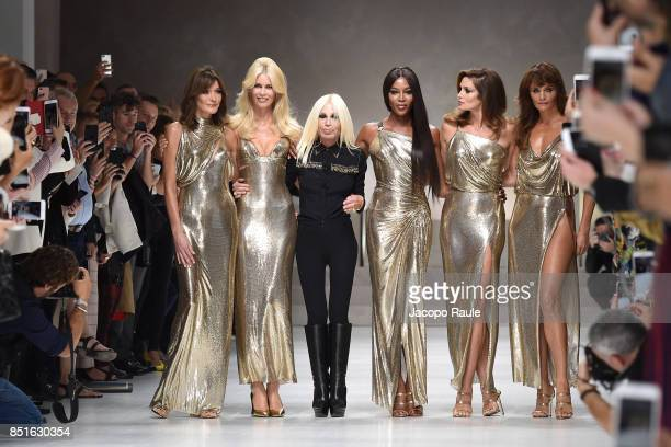 Carla Bruni Claudia Schiffer Naomi Campbell Cindy Crawford Helena Christensen and Donatella Versace walk the runway at the Versace show during Milan...