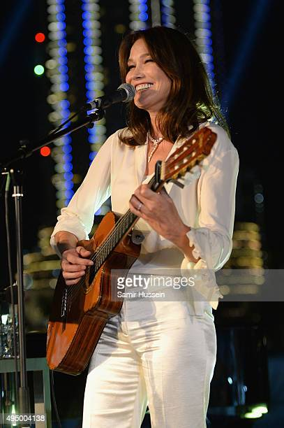Carla Bruni performs live at the Gala event during the Vogue Fashion Dubai Experience 2015 at Armani Hotel Dubai on October 30 2015 in Dubai United...