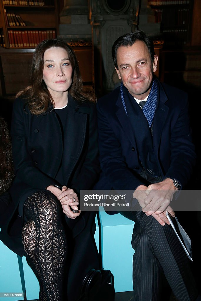 Carla Bruni Sarkozy and Chief Executive of LVMH Fashion Group Pierre-Yves Roussel attend the Givenchy Menswear Fall/Winter 2017-2018 show as part of Paris Fashion Week on January 20, 2017 in Paris, France.