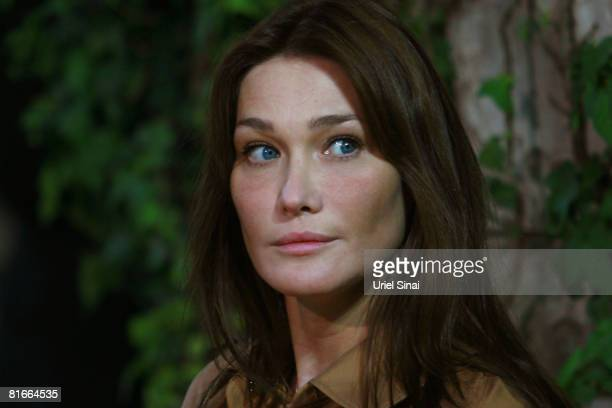 Carla Bruni Sarkozy attends an official ceremony at Israeli President's Shimon Peres residence as her husband French president Nicolas Sarkozy visits...