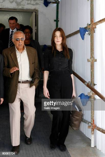 Carla Bruni wife of French President Nicholas Sarkozy listens to former detainee Ahmed Kathrada during their visit to Robben Island on February 29...