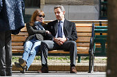 Carla BruniSarkozy and former French President Nicolas Sarkozy sit on a bench after they voted on March 23 2014 in Paris France Municipal elections...