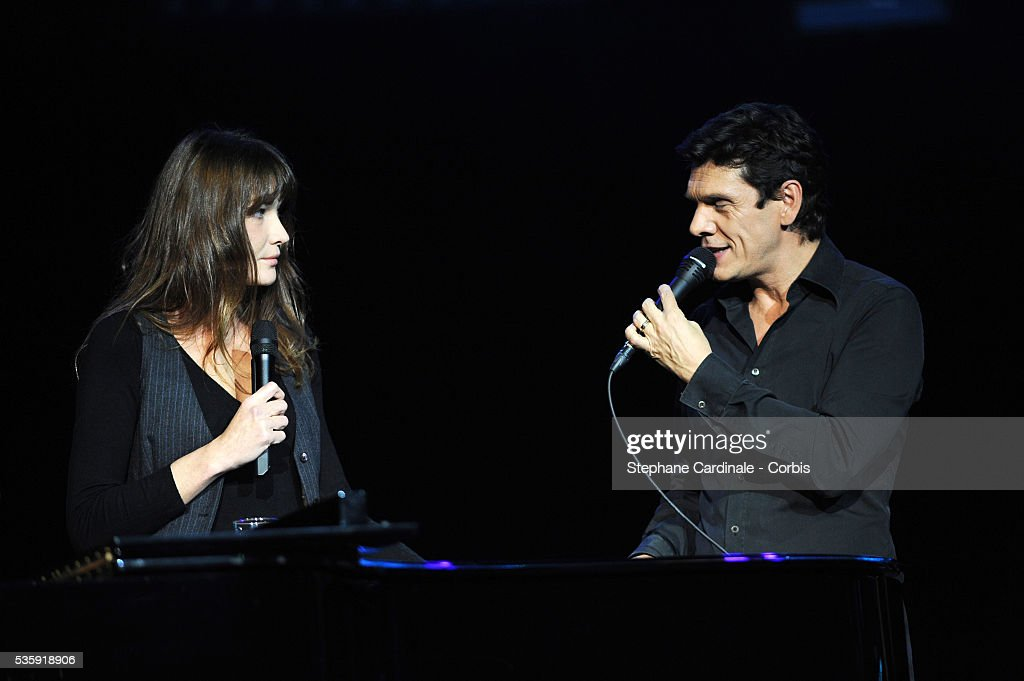 Carla Bruni-Sarkozy and Marc Lavoine perform live during the celebration of Prix Constantin 2010 at L'Olympia, in Paris