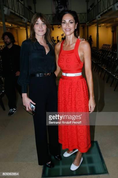 Carla BruniSarkozy and Tasha de Vasconcelos attend the Azzedine Alaia Fashion Show as part of Haute Couture Paris Fashion Week Held at Azzedine Alaia...