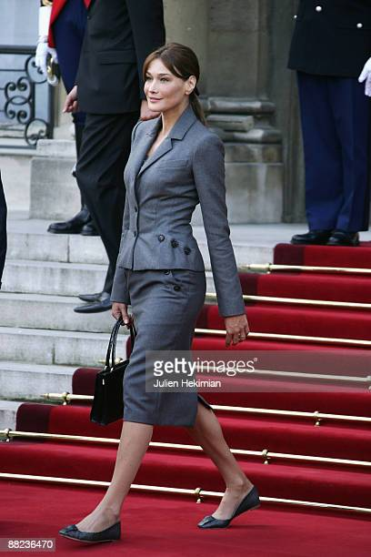 Carla BruniSarkozy greets pope Benedict XVI as he leaves the courtyard of the Elysee Palace on September 12 2008 in Paris France