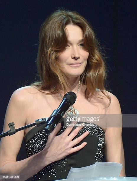 Carla BruniSarkozy onstage during amfAR's 21st Cinema Against AIDS Gala Presented By WORLDVIEW BOLD FILMS And BVLGARI at Hotel du CapEdenRoc on May...