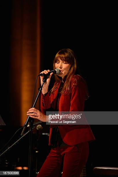 Carla BruniSarkozy performs on stage on November 9 2013 in Courbevoie France