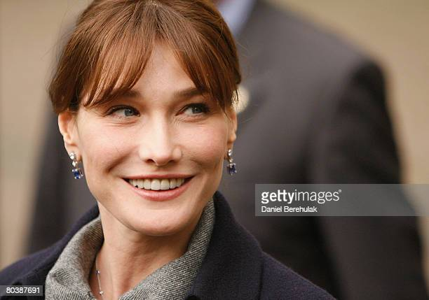 Carla BruniSarkozy smiles as she departs from Westminster Abbey on March 26 2008 in London England President Nicolas Sarkozy and his wife Carla...