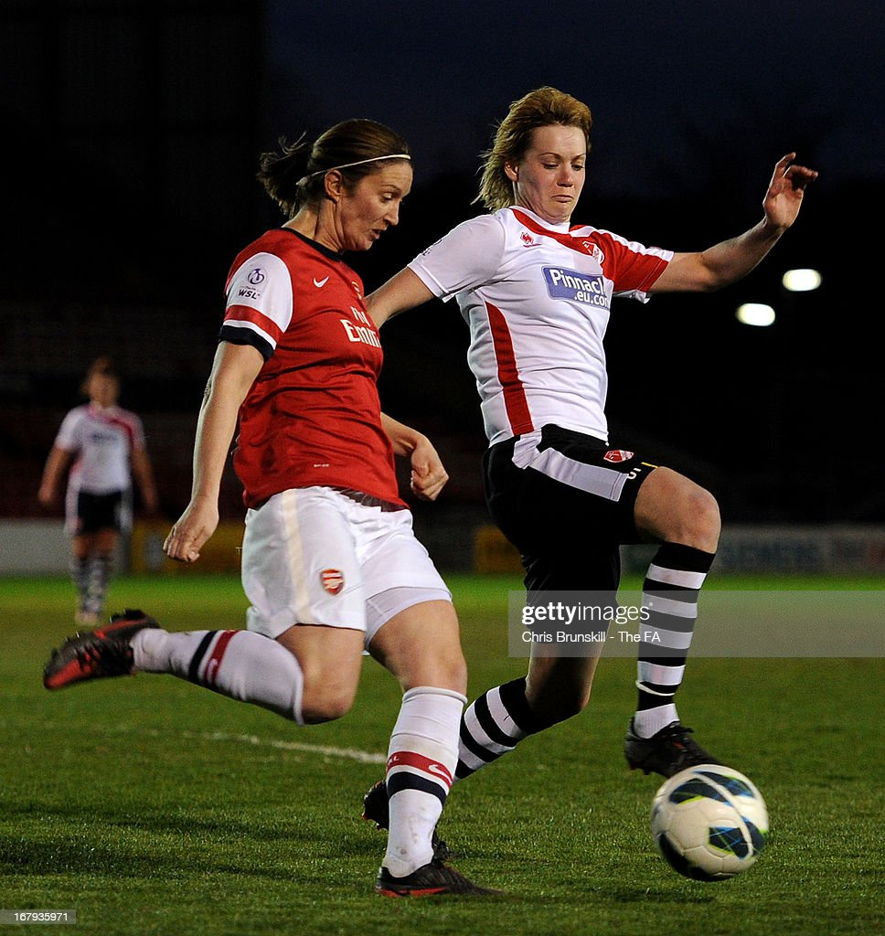 Carla Cantrell (R) of Lincoln Ladies in action with Ciara Grant of Arsenal Ladies during the The FA WSL Continental Cup match between Lincoln Ladies and Arsenal Ladies at Sincil Bank Stadium on May 2, 2013 in Lincoln, England.