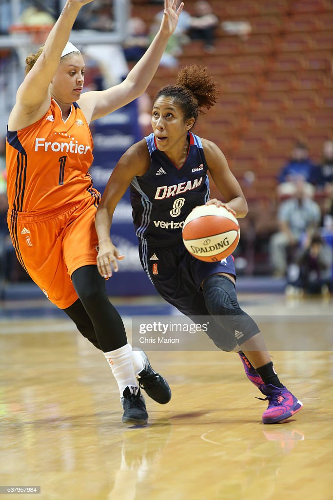 Carla Cortijo #8 of the Atlanta Dream dribbles the ball against <a gi-track='captionPersonalityLinkClicked' href=/galleries/search?phrase=Rachel+Banham&family=editorial&specificpeople=12429228 ng-click='$event.stopPropagation()'>Rachel Banham</a> #1 of the Connecticut Sun on June 3, 2016 at Mohegan Sun Arena in Uncasville, CT.