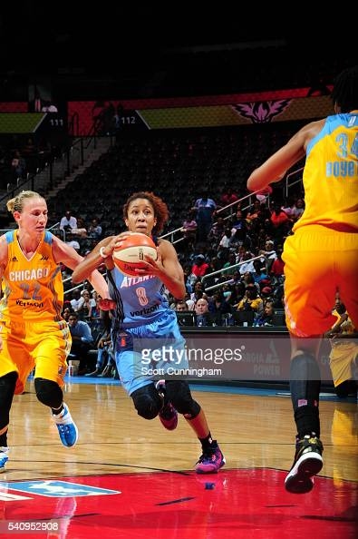 Carla Cortijo of the Atlanta Dream drives to the basket against Courtney Vandersloot of the Chicago Sky on June 17 2016 at Philips Arena in Atlanta...