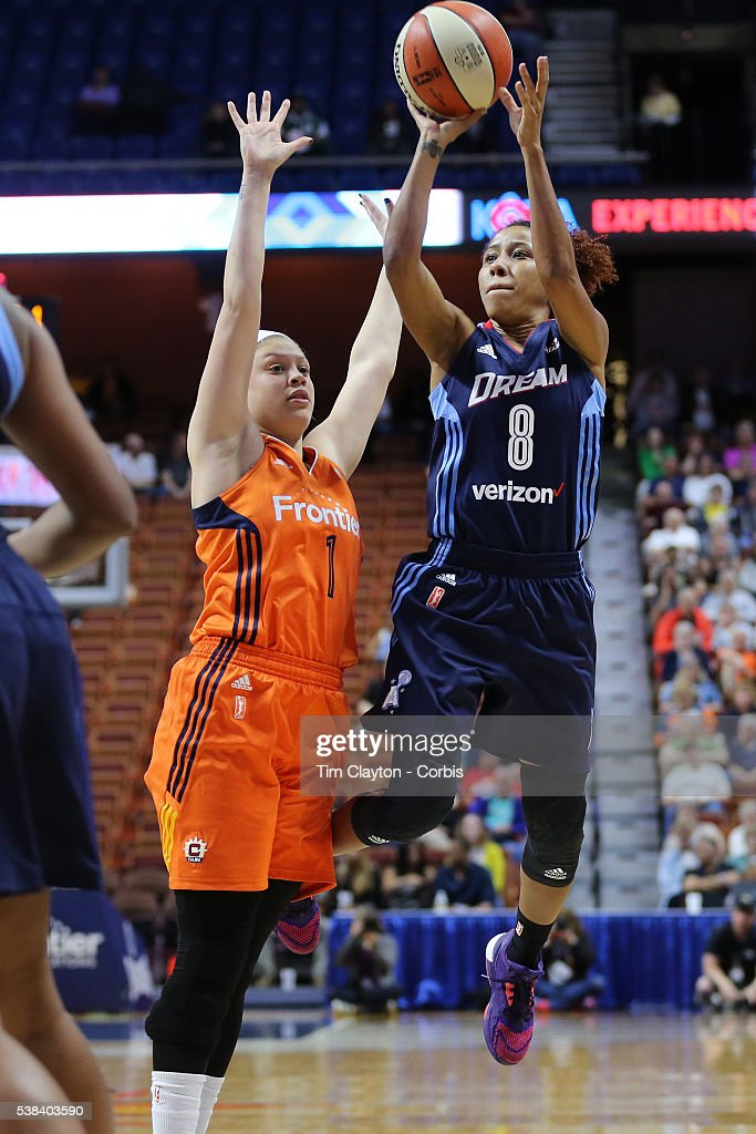Carla Cortijo #8 of the Atlanta Dream shoots while defended by <a gi-track='captionPersonalityLinkClicked' href=/galleries/search?phrase=Rachel+Banham&family=editorial&specificpeople=12429228 ng-click='$event.stopPropagation()'>Rachel Banham</a> #1 of the Connecticut Sun during the Atlanta Dream Vs Connecticut Sun, WNBA regular season game at Mohegan Sun Arena on June 3, 2016 in Uncasville, Connecticut.