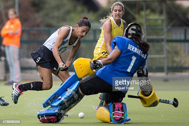 Carla Dupuy of Argentina attacks as Andrea Gomes Bernardes of Brazil defends during a match between Argentina and Brazil during day nine of the X...