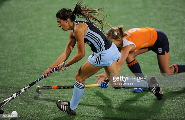 Carla Dupuy of Argentina breaks clear of Wieke Dijkstra of the Netherlands during their Women's Champions Trophy hockey match in Sydney on July 16...