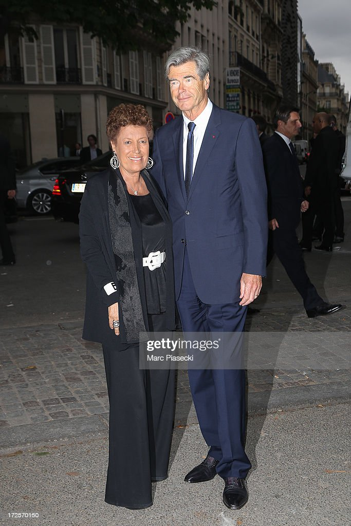 <a gi-track='captionPersonalityLinkClicked' href=/galleries/search?phrase=Carla+Fendi&family=editorial&specificpeople=676894 ng-click='$event.stopPropagation()'>Carla Fendi</a> and guest arrive to attend the 'The Glory of Water' Karl Lagerfeld's exhibition at FENDI store on Avenue Montaigne on July 3, 2013 in Paris, France.