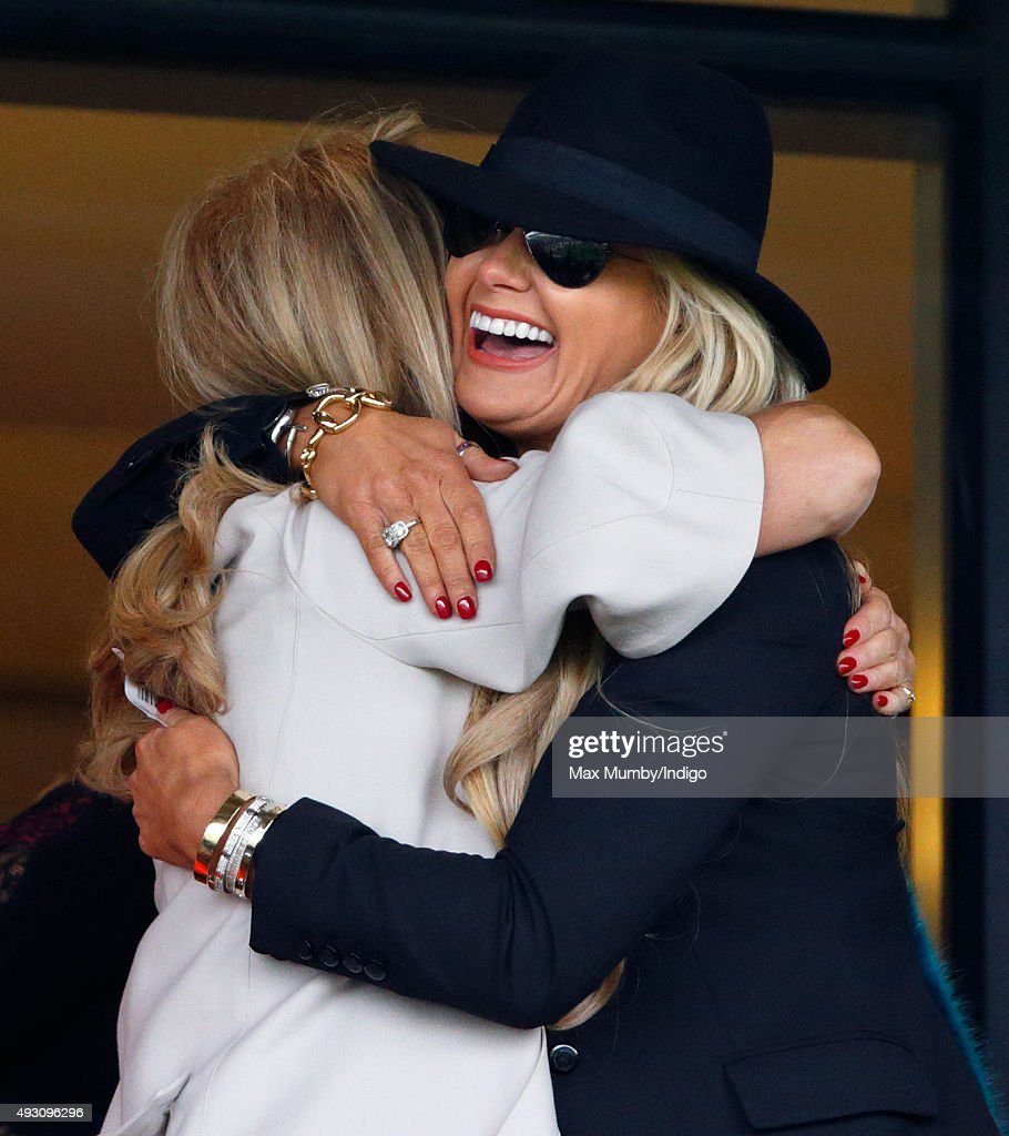 Carla Germaine (r) attends the QIPCO British Champions Day racing meet at Ascot Racecourse on October 17, 2015 in Ascot, England.