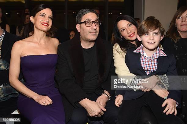 Carla Gugino Jason Weinberg Lucy Liu and Jasper Weinberg attend the Zac Posen Fall 2016 fashion show during New York Fashion Week at Spring Studios...