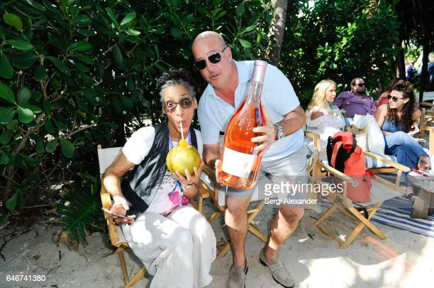 Carla Hall and Andrew Zimmern attend during SiriusXM's Food Talk with Geoffrey Zakarian at Miami Beach EDITION on February 24 2017 in Miami Florida