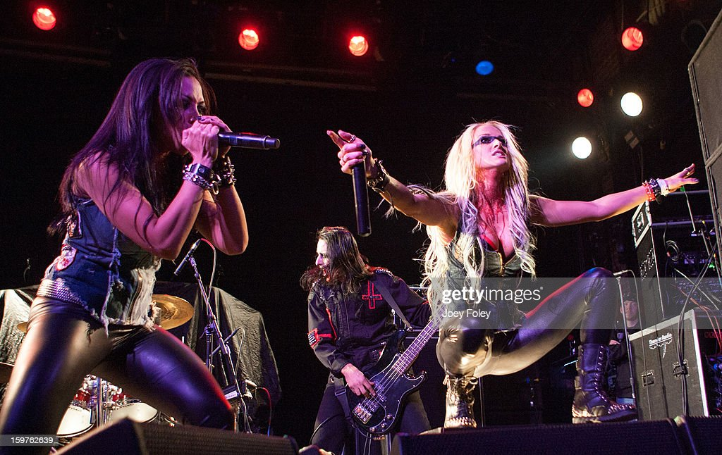 Carla Harvey, Jason Klein, and Heidi Shepherd of Butcher Babies performs onstage at Bogart's on January 19, 2013 in Cincinnati, Ohio.