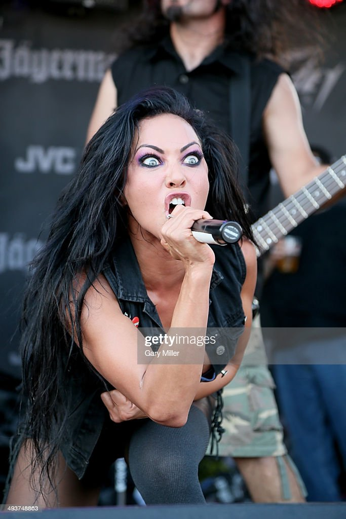 <a gi-track='captionPersonalityLinkClicked' href=/galleries/search?phrase=Carla+Harvey&family=editorial&specificpeople=8535893 ng-click='$event.stopPropagation()'>Carla Harvey</a> performs in concert with Butcher Babies during the River City RockFest at the at&t Center on May 24, 2014 in San Antonio, Texas.