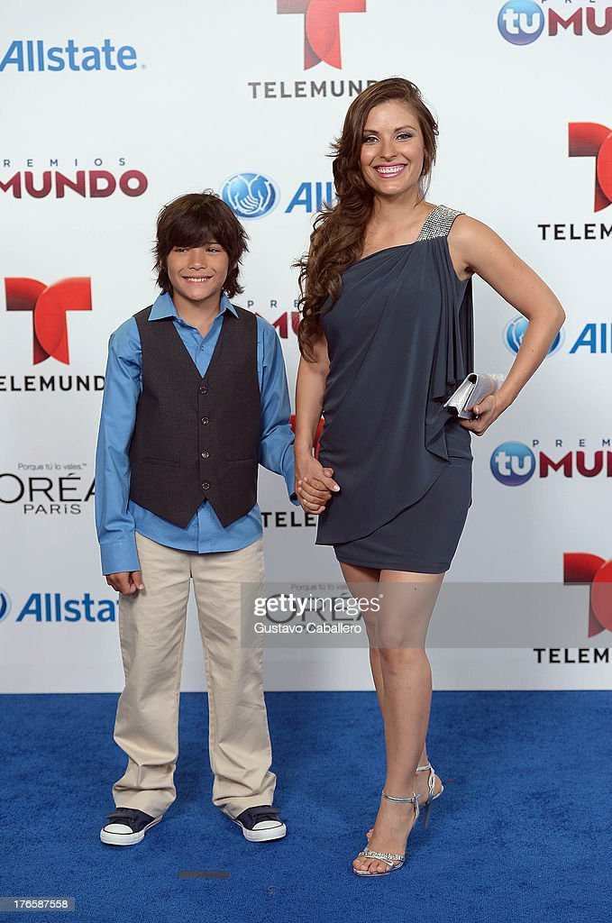 Carla Hernandez (R) and son arrive for Telemundo's Premios Tu Mundo Awards at American Airlines Arena on August 15, 2013 in Miami, Florida.