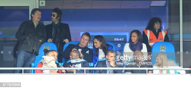 Carla Higgs wife of Manchester City's Vincent Kompany sits with his father and brother in a private box along with OASIS singer Liam Gallagher