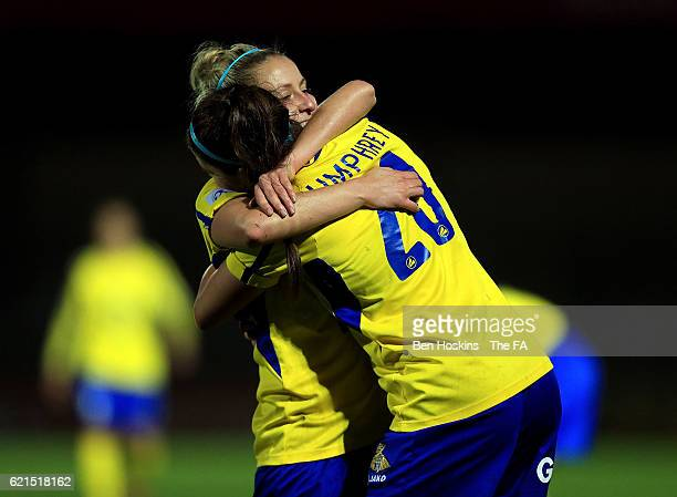 Carla Humphrey and Sophie Barker of Doncaster celebrate their team's victory ahead of the WSL match between Reading FC Women and Doncaster Rovers...