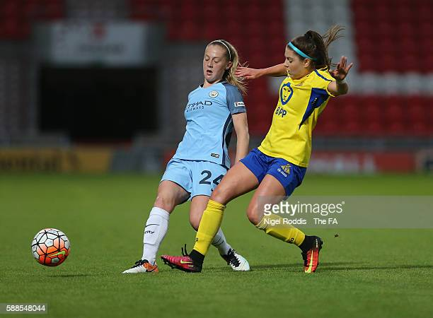 Carla Humphrey of Doncaster Rovers Belles challenges Kiera Walsh of Manchester City Women during the WSL1 match between Doncaster Rovers Belles and...