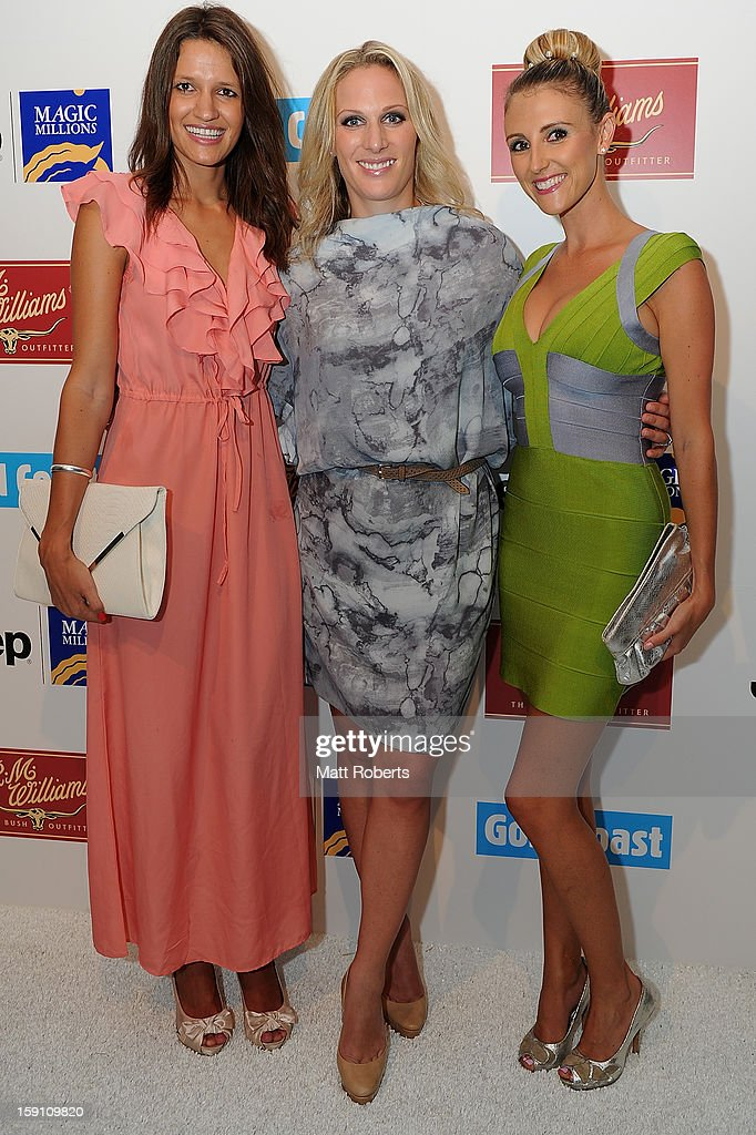 Carla Jenkins, Zara Phillips and Tash Thompson pose during the Magic Millions Opening Night cocktail party at Surfers Paradise foreshore on January 8, 2013 in Surfers Paradise, Australia.