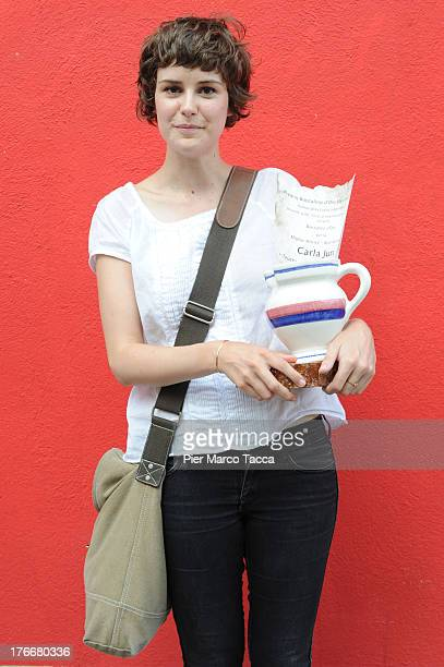 Carla Juri poses with the Boccalino award during the 66th Locarno Film Festival on August 16 2013 in Locarno Switzerland