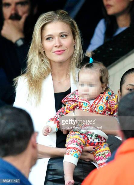 Carla Pereyra and her daughter Francesca Simeone are seen during the Champions League quarter final first leg match between Club Atletico de Madrid...