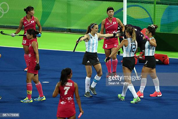 Carla Rebecchi Delfina Merino and Maria Granatto of Argentina celebrate a goal as Yukari Mano Aki Mitsuhashi and Nagisa Hayashi of Japan look on...