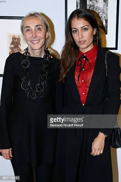 Carla Sozzani and actress Hiba Abouk attend the Carla Sozzani Photo Exhibition at Azzedine Alaia Gallery on November 9 2016 in Paris France