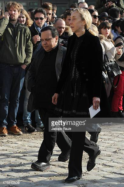Carla Sozzani and Azzedine Alaia arrive at the Louis Vuitton show as part of the Paris Fashion Week Womenswear Fall/Winter 20142015 on March 5 2014...