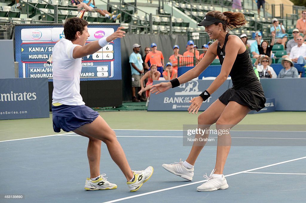 <a gi-track='captionPersonalityLinkClicked' href=/galleries/search?phrase=Carla+Suarez+Navarro&family=editorial&specificpeople=5294252 ng-click='$event.stopPropagation()'>Carla Suarez Navarro</a> (white shirt) and Garbine Muguruza of Spain celebrate after they defeated Paula Kania of Poland and Katerina Siniakova of the Czech Republic in the doubles final of the Bank of the West Classic at the Taube Family Tennis Stadium on August 3, 2014 in Stanford, California.