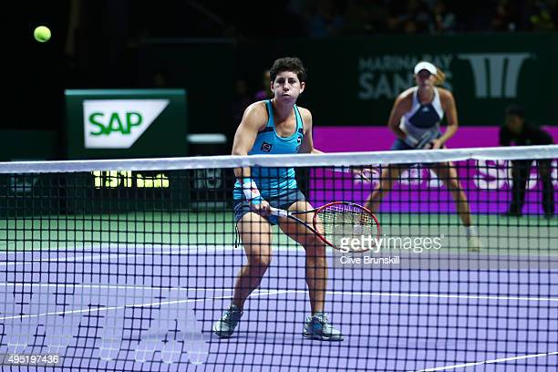 Carla Suarez Navarro and Garbine Muguruza of Spain win action during their doubles final match against Martina Hingis of Switzerland and Sania Mirza...