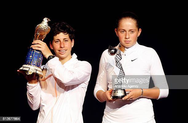 Carla Suarez Navarro of Spain and Jelena Ostapenko of Latvia pose with their trophies at the end of their Qatar Open final tennis match in Qatar Doha...