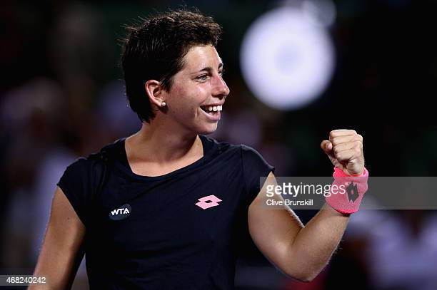 Carla Suarez Navarro of Spain celebrates after her three set victory against Venus Williams of the United States in their quarter final match during...