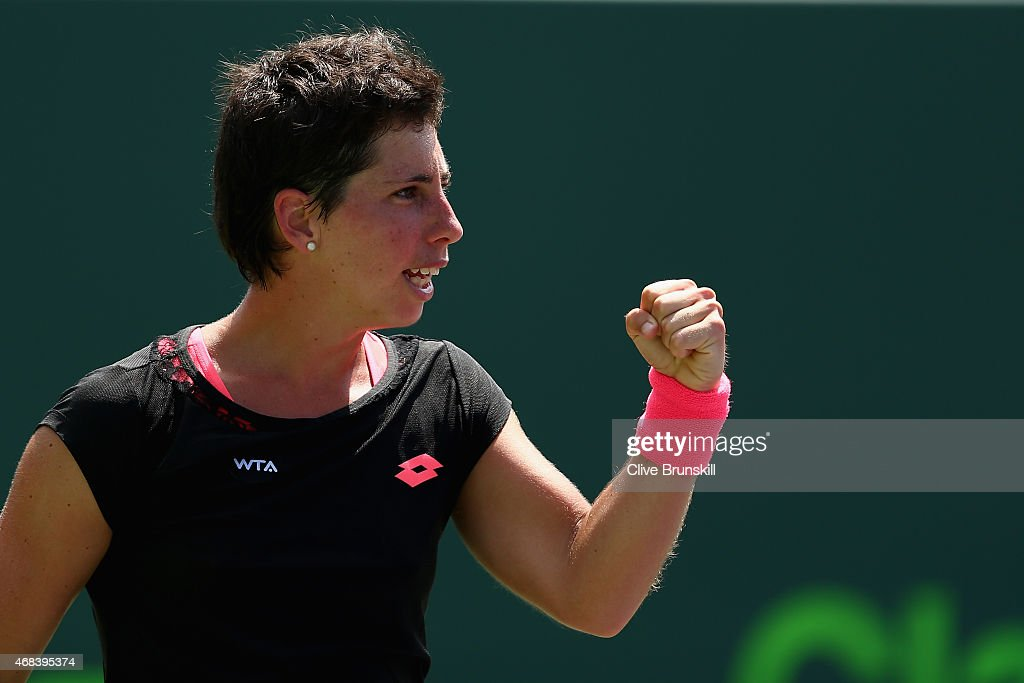<a gi-track='captionPersonalityLinkClicked' href=/galleries/search?phrase=Carla+Suarez+Navarro&family=editorial&specificpeople=5294252 ng-click='$event.stopPropagation()'>Carla Suarez Navarro</a> of Spain celebrates match point against Andrea Petkovic of Germany in their semi final match during the Miami Open Presented by Itau at Crandon Park Tennis Center on April 2, 2015 in Key Biscayne, Florida.